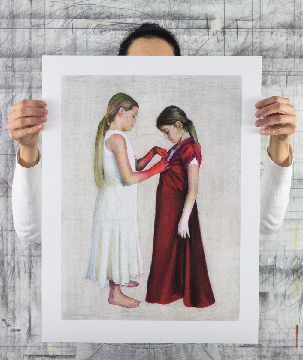 An image of contemporary artist Angelika Vaxevanidou holding a limited edition fine art print